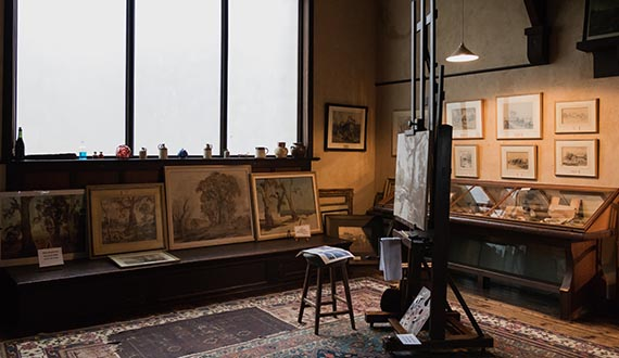 A painter's studio, lined with watercolours and heritage-style furnishings
