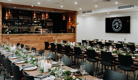 A conference set up in a modern venue with rustic wooden furnishings